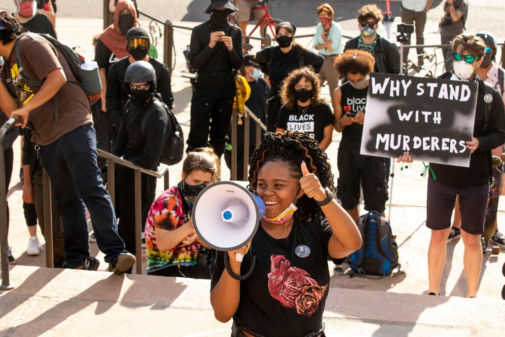 Ashira Campbell speaks about Black women as protesters gather in front of the State Capitol building to decry police brutality, racial injustice and the threat of federal agents in the metro. July 24, 2020.