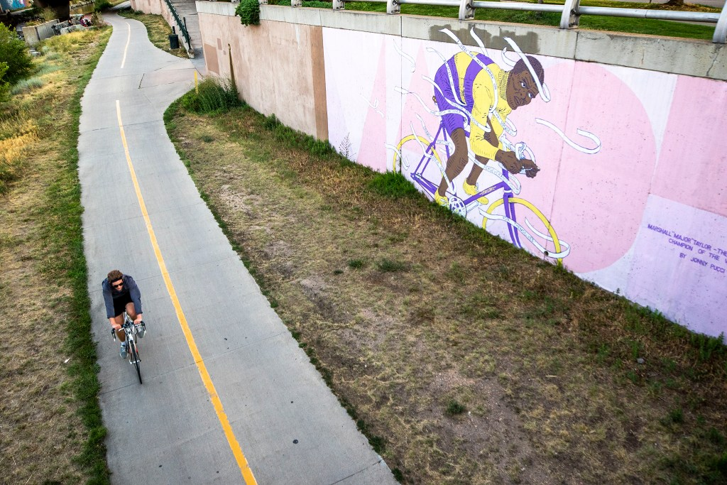 A mural of Major Taylor by Jonathan Pucci on the Cherry Creek Trail by Market Street. July 29, 2020.