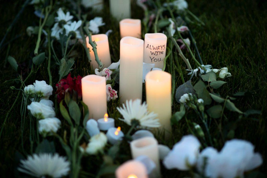 Candles and flowers for Elijah McClain Vigil