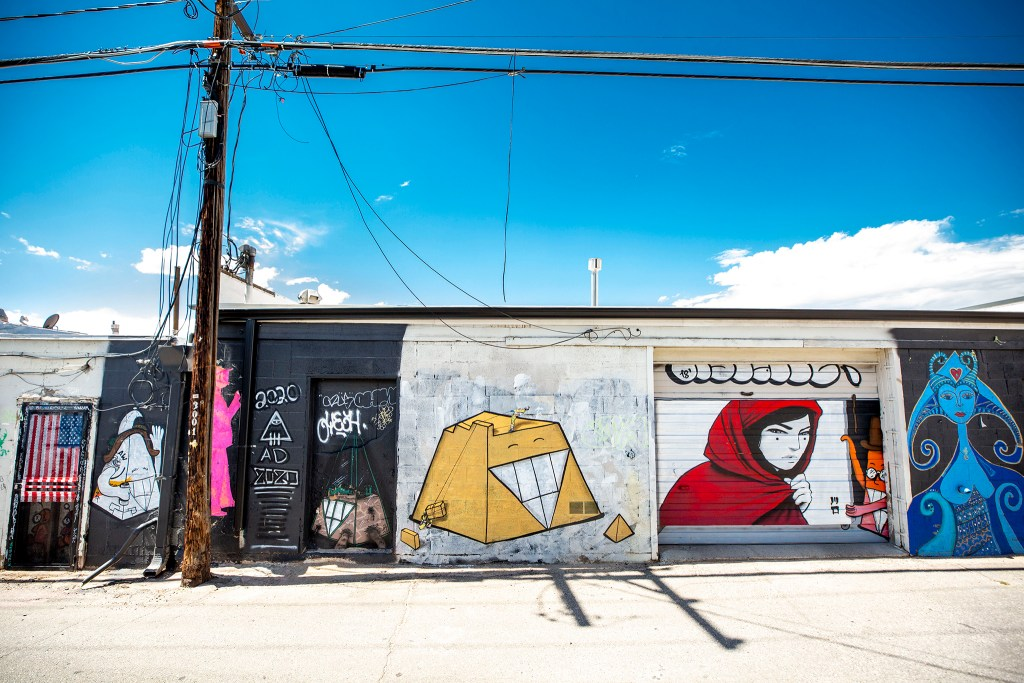 Work by Chris Haven, Jaune Marion and Casey Kawaguchi behind the DATELINE Gallery on Larimer Street in Five Points. Aug. 12, 2020.