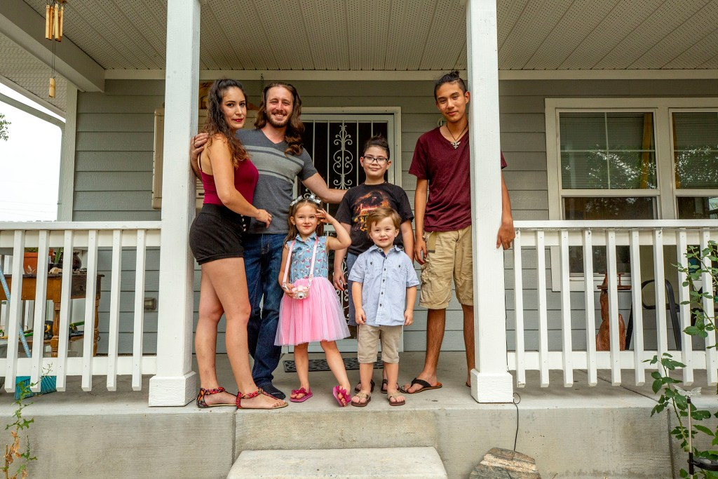 Phillip Stonaker with his wife, Heidy, and kids, Brienne (4), Maximus (3), Alan (10) and Chris (14),  at their home in Westwood. Aug. 20, 2020.