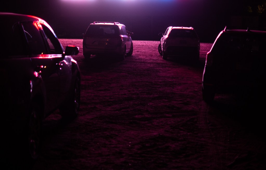 The screen illuminates cars during the 21st annual Film on the Rocks, drive-in edition at Red Rocks Park on Aug. 13, 2020.