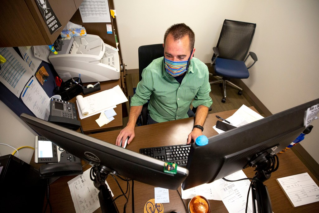 Ian Harwick, an administrator with Denver's Office of the Medical Examiner, at work on Aug. 25, 2020.