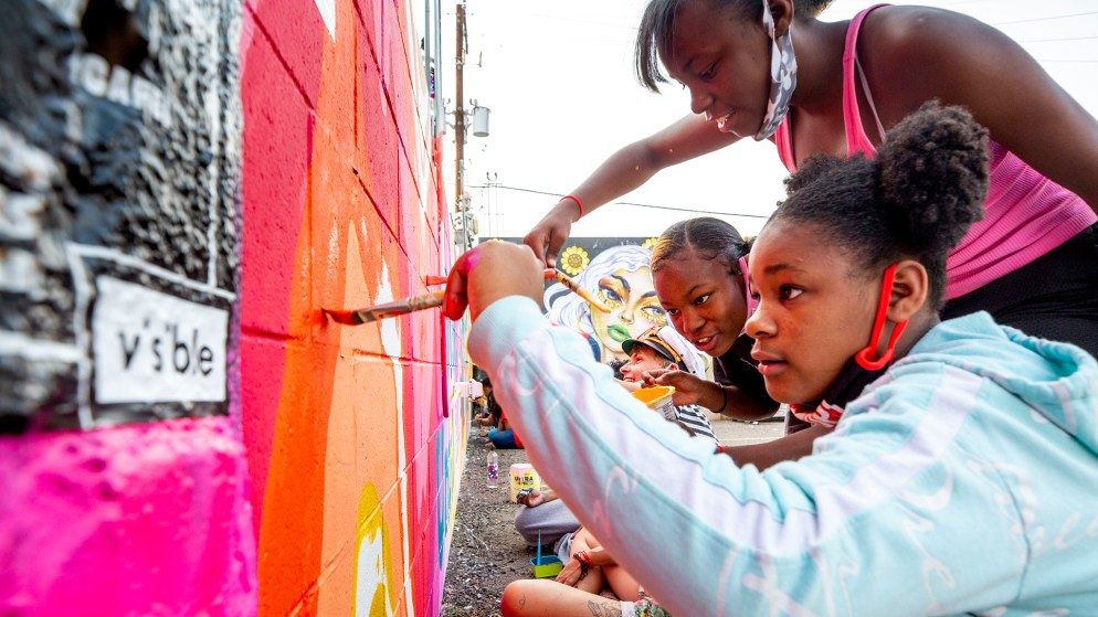 Jasmine (left to right), Jadah and Jordan Ward paint a wall during CRUSH Walls 2020 outside of Denver Central Market on Larimer Street. Sept. 18, 2020.