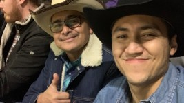 My father, Esteban Hernandez, me (right, with L.) during the PBR Chute Out at the National Western Stock Show on Monday, Jan. 13., 2020. (Esteban L. Hernandez/Denverite)
