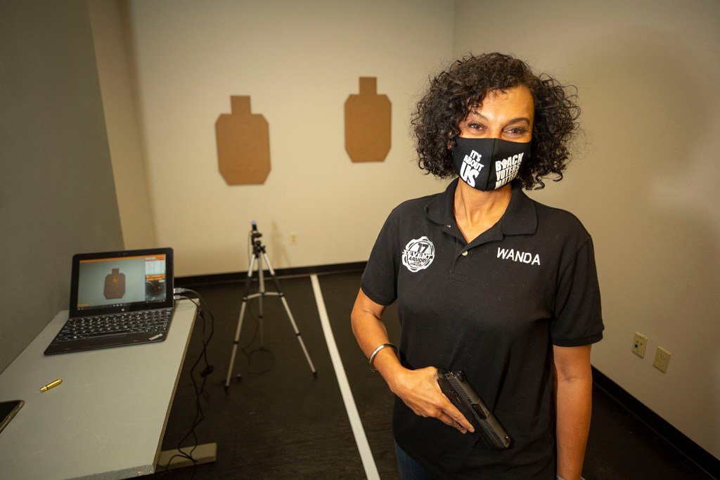 """The 17 Seventy Armory and Gun Club co-owner Wanda James stands in her new """"virtual"""" range in Five Points. Oct. 20, 2020."""
