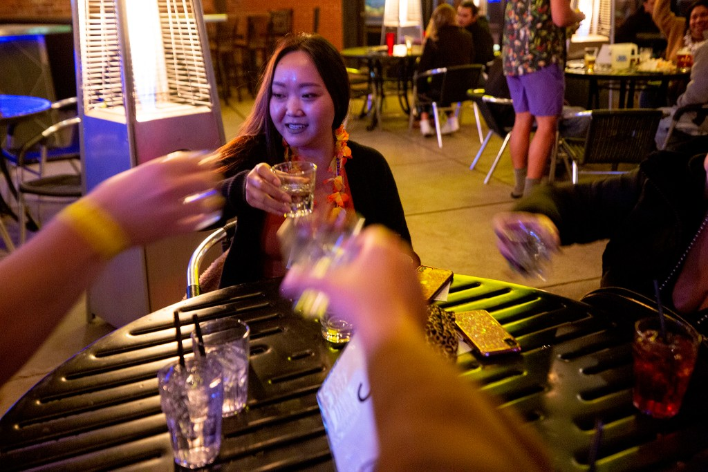 May Gantugs clinks glasses with an old friends and two new ones as the Denver Pub Crawl group prepares to leave its first stop at Brother's Bar and Grill in LoDo. Oct. 23, 2020.
