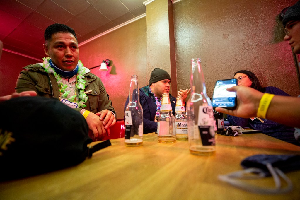 A group with the Denver Pub Crawl hangs out in the back room at El Chapultepec. Oct. 23, 2020.