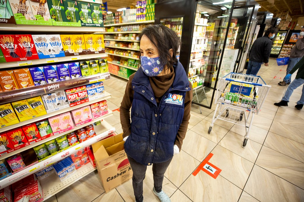 Christina Lam, manager at Pacific Ocean Marketplace, at work in the Athmar Park grocery store. Nov. 10, 2020.