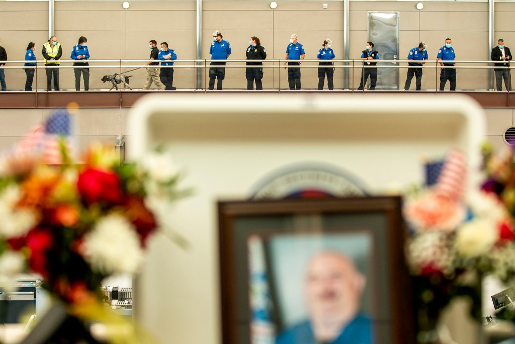 TSA agents gather inside DIA's terminal for a memorial to their colleague, Eduard Faktorovich, who died after contracting COVID-19. Nov, 21, 2020.