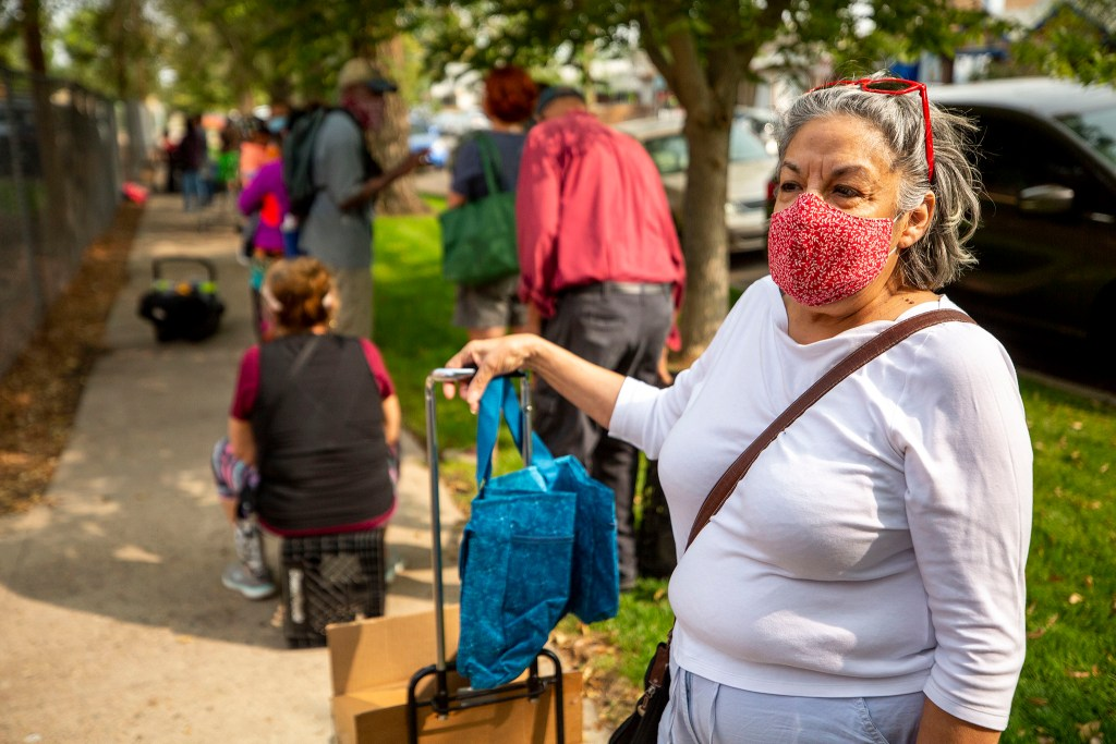 Jan Chavez waits in line for a food pantry set up outside Wyatt Academy in Cole. Sept. 16, 2020.