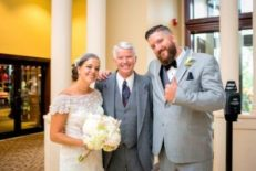 Officiant Ray Cross celebrates an awesome wedding with bride and groom, Colleen and Gavin