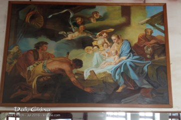 """As I recall, the church had two main rooms: one with """"Sunday seating"""" and one with an open space. Above the second, I found this pretty painting of the Christmas story."""