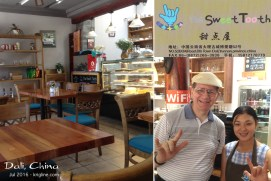 "Inside The Sweet Tooth, restaurant and bakery. If you don't know what the hand sign means, it's ""I love you."" The bakers are deaf, which reminded me of a similar bakery run by a friend of mine in Changsha."
