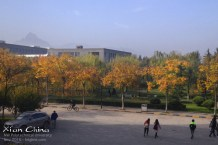 """Our first stop this trip was to visit the """"new campus"""" of NPU (it was under construction when I worked there). We really enjoyed seeing the beautiful fall leaves (which we don't have in Hong Kong). The campus is at the edge of the city near the beautiful mountains, which unfortunately give the pollution no route of escape! But for our first two days, the air was clear and the sky was blue."""