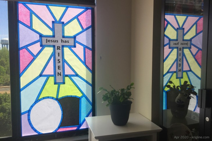 """This year, I made this special """"Easter Window"""" of pastel-colored tissue paper, connected with blue """"painters' tape."""" Someday, I hope to find time to describe in detail how it was constructed!"""