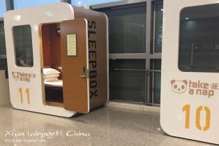"""I forgot to include this photo from the Xi'an airport. I'd never seen a """"nap box"""" before, but it's a great idea for travelers. (But I think they need to be """"inside"""" for those with a layover, inside of out by check-in desks.)"""