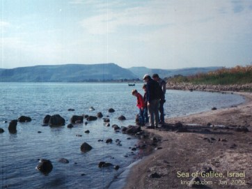 Michael, our son Andrew, and friends on the shore of the Sea of Galilee. (2002)