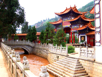 Michael's first teaching job in Kunming was at YNUBS, just down the road from this temple. Kunming is dry most of the year, but this was taken in the fall rainy season (which accounts for the muddy river).