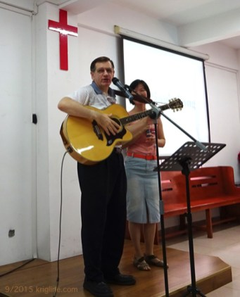 "With interpreter Faith behind me, I prepare to sing ""Vivian's song"" at the Bridge. (The day's topic was ""how to find the perfect mate"". Look for it at MATB.org.)"