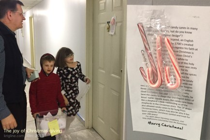 "We love ""giving,"" especially around Christmas, so we wanted our grandchildren to see the ""best side"" of Christmas. Here, we give candy canes to our neighbors, complete with a description of the meaning of this holiday treat."