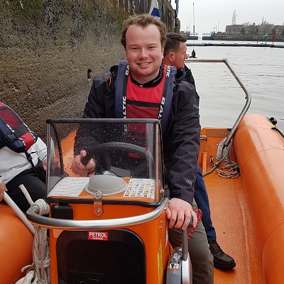 Giles Exley training to use a power boat