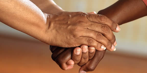 a photograph of clasped hands