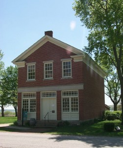 Red brick store in Nauvoo, public domain.