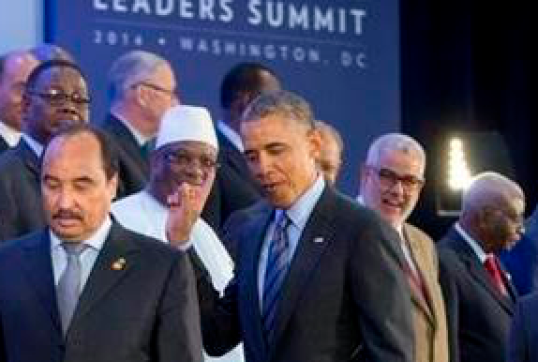 Barack Obama gestures the Shahada to delegates of the US-African Leaders Conference, Washington, D.C., August 2014. Courtesy of the Associated Press.