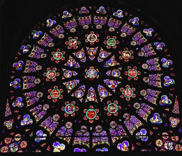 "The North Rose Window of The Saint Denis Cathedral is called, ""The Creation."" ""God the Creator,"" is in the center surrounded by ""The Days of Creation."" These are surrounded by each of the twelve signs of the Zodiac, which represent ""The Order of the Heavens."" Next, the ""Labor of the Months"" depict the ""Order of Earth."" In each corner outside of this circle of life are images of the ""Fall of Mankind."" Originally constructed c. 1145, repaired 1805. Paris, France."