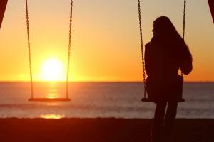 A woman alone on a swing