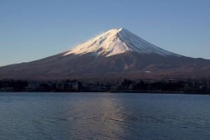 """FujiSunriseKawaguchiko2025WP"". Licensed under Public Domain via Commons - https://commons.wikimedia.org/wiki/File:FujiSunriseKawaguchiko2025WP.jpg#/media/File:FujiSunriseKawaguchiko2025WP.jpg"