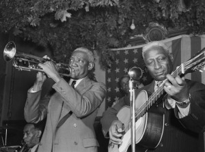 """Bunk Johnson, Leadbelly, George Lewis, Alcide Pavageau (Gottlieb 04541)"" by William P. Gottlieb - This image is available from the United States Library of Congress's Music Division under the digital ID gottlieb.04541.This tag does not indicate the copyright status of the attached work. A normal copyright tag is still required. See Commons:Licensing for more information.العربية 
