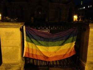 Rainbow flag. Oxford, UK vigil for Orlando. Photo by Yvonne Aburrow. CC-BY-SA 4.0