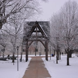 Snow-covered chime tower in campus center