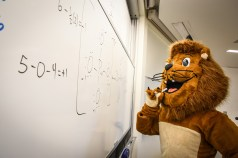Ole the Lion in a classroom