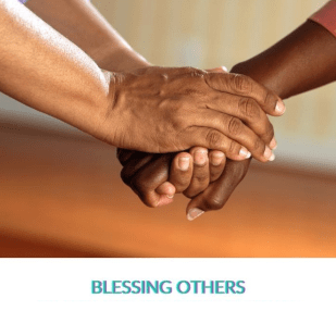 """Two people holding hands with the caption """"Blessing Others"""""""