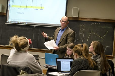 Carleton College Associate Professor of Political Science Greg Marfleet answers a St. Olaf student's questions during the collaborative course that he teaches.
