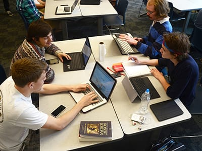 Students in the Ethical Issues in Software Design course work together on a project.