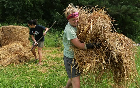 Malika Dale '16 and Katie Myhre '16 work with local farmers.