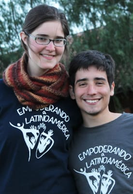 St. Olaf students Maggie Schenk '16 (left) and Pedro Monque '16 pose for a portrait in front of a tree wearing their Empoderando a Latinoamerica t-shirts.