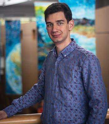 St. Olaf College student Oleksandr (Sasha) Dmytrenko stands in Buntrock Commons.