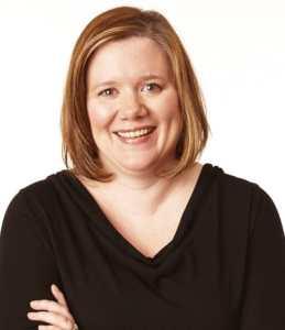 Katie Warren is dressed in black against a plain white background