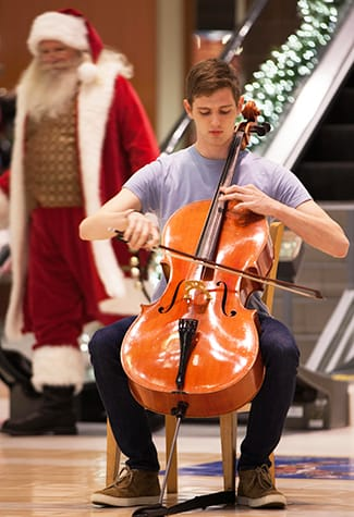 """Sam Viguerie '17 performs """"Beautiful Savior"""" — a deeply moving arrangement by St. Olaf Choir founder F. Melius Christiansen — at the beginning of a recent Christmas Festival pop-up performance at Southdale Center. Watch the performance here."""