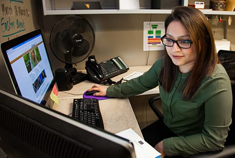 Student working in the St. Olaf Admissions Office.