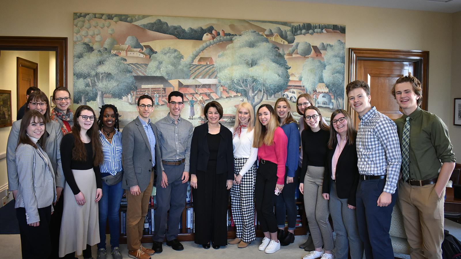 U.S. Senator Amy Klobuchar (center) welcomes a St. Olaf Interim class to her Senate office in Washington, D.C.