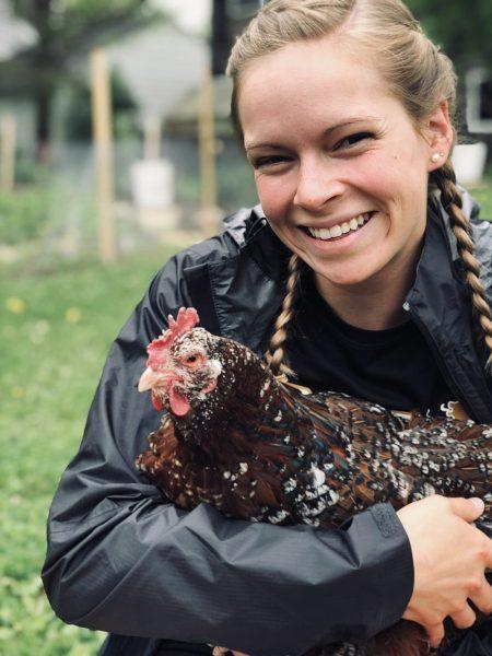 Samantha Waddell '18 holding a chicken.