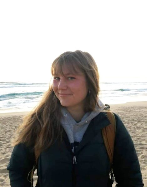 Portrait of student technician Megan Kartheiser at the beach in front of the ocean.