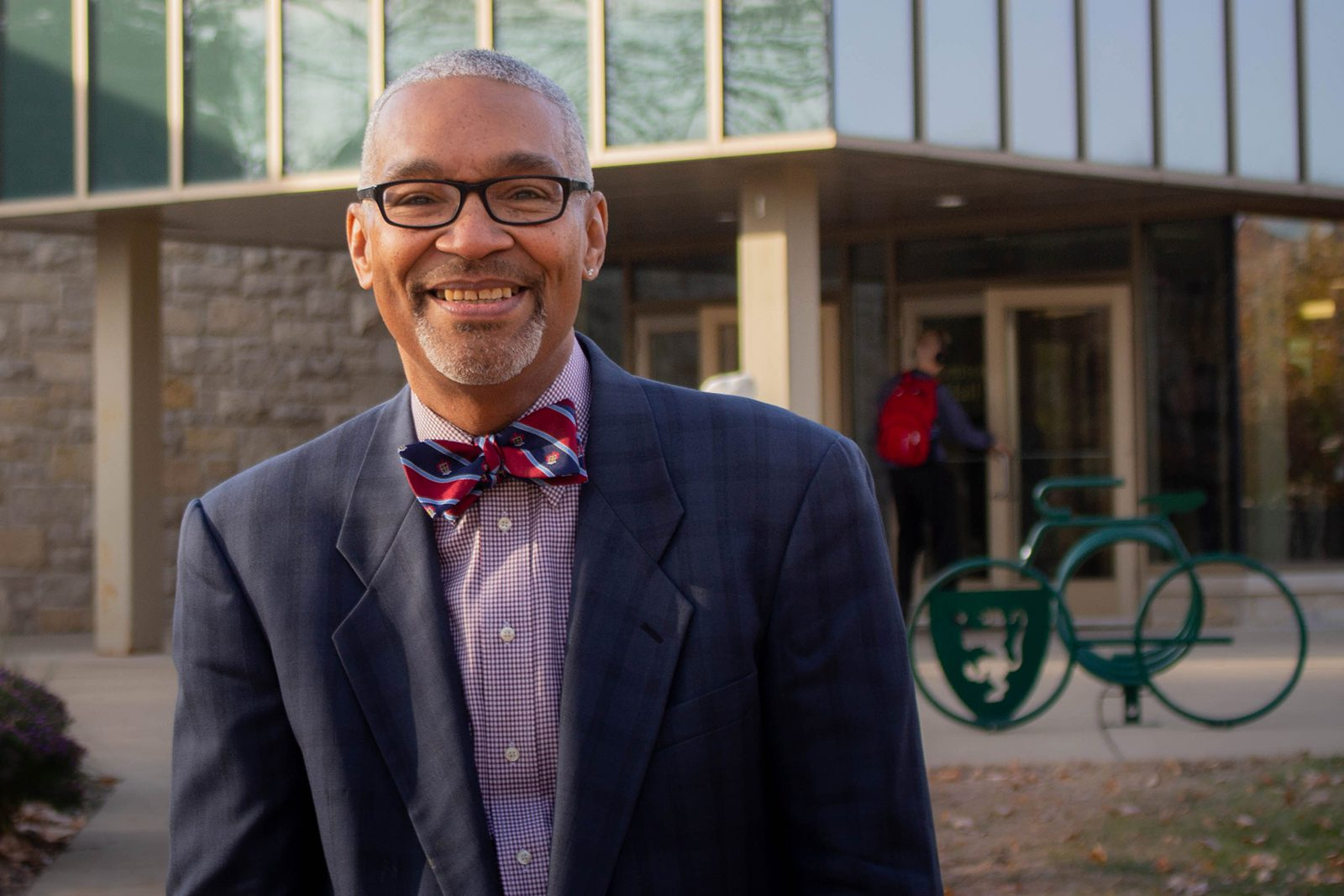 Portrait of Vice President for Equity and Inclusion Bruce King outside Tomson Hall.