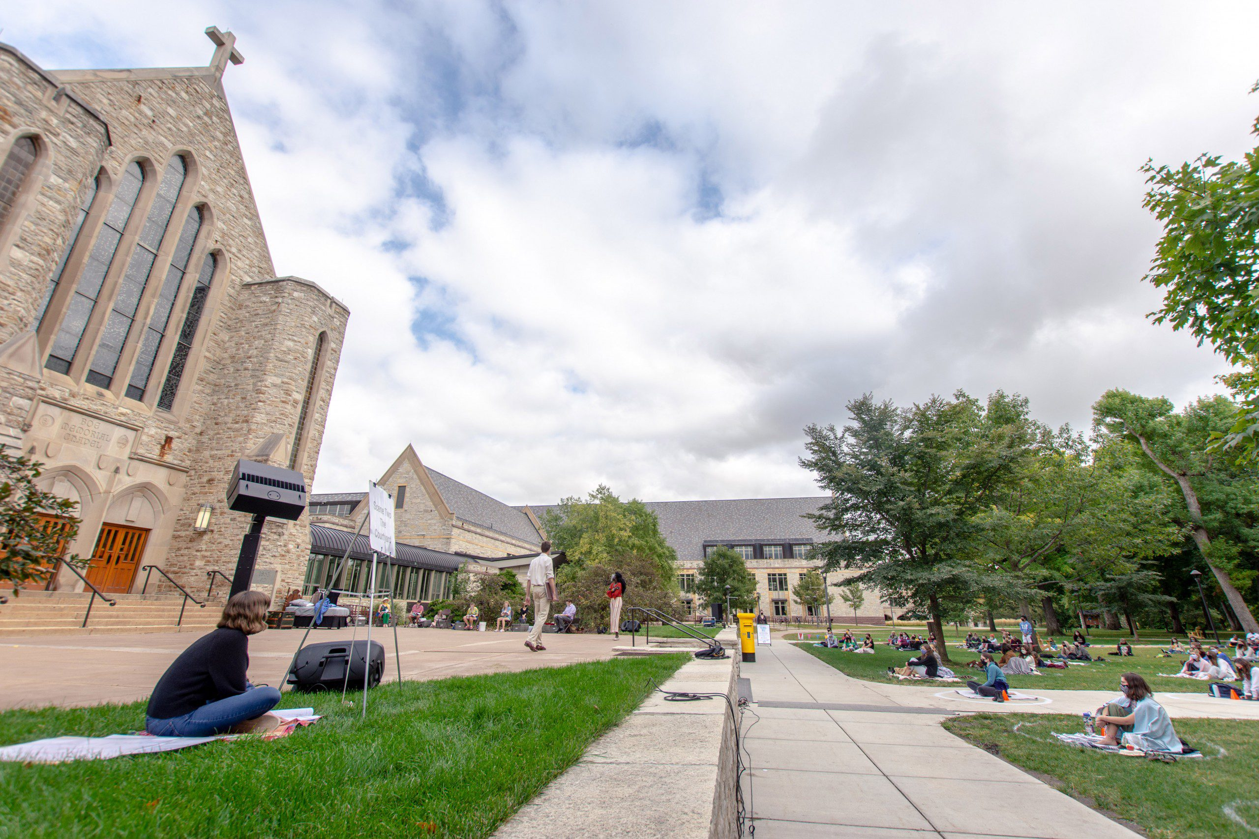 Photo of St. Olaf campus with performers on Boe Chapel plaza.
